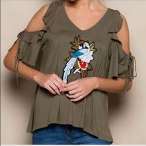 Cold shoulder top with embroidered front.